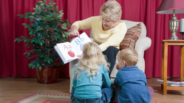 image senior reading to children